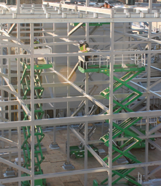 CCS open tower structure being erected using scissor lifts